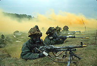 British army NBC exercise in Chemical weapon warfare at Porton Down, UK in 1980. The first soldier on the left is equipped with a GPMG, the soldiers next to him with L1A1 SLRs. Note the yellow BFA's on the end of their weapons, used to signify the use of blank ammunition. Photograph by Terry Fincher