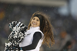 A Philadelphia Eagles Cheerleader performs during the NFL game between the Detroit Lions and the Philadelphia Eagles on Sunday, December 8th 2013 in Philadelphia. The Eagles won 34-20. (Photo by Brian Garfinkel)