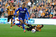 Cardiff city's Fraizer Campbell goes past Hull's Curtis Davies. Barclays Premier league match, Hull city v Cardiff city at the KC Stadium in Hull on Sat 14th Sept 2013. pic by Andrew Orchard, Andrew Orchard sports photography,
