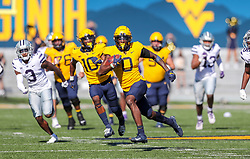 Oct 31, 2020; Morgantown, West Virginia, USA; West Virginia Mountaineers wide receiver Bryce Ford-Wheaton (0) runs after a catch during the second quarter against the Kansas State Wildcats at Mountaineer Field at Milan Puskar Stadium. Mandatory Credit: Ben Queen-USA TODAY Sports