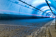 Long exposure of the inside of a artificially illuminated traffic tunnel