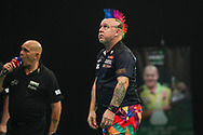 Peter Wright dejected as he misses a darts at a double during the Unibet Premier League Play-Offs at the Ricoh Arena, Coventry, England on 15 October 2020.