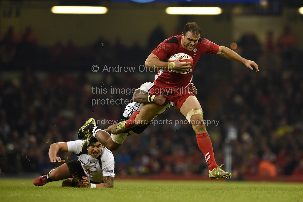Jamie Roberts  of Wales is tackled by Fiji's Nikola Matawalu. Dove Men series 2014, autumn international rugby, Wales v Fiji at the Millennium Stadium in Cardiff, South Wales on Saturday 15th November 2014.<br /> pic by Andrew Orchard, Andrew Orchard sports photography.