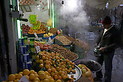 Putting boiling water on cooked beets at a market near the Bazaar near Imam Square, in Isfahan, Iran.