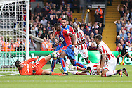 Wilfried Zaha of Crystal Palace tries to get on the end of the ball during a scramble in the box as Goalkeeper Shay Given of Stoke City saves with his leg.. . Premier League match, Crystal Palace v Stoke city at Selhurst Park in London on Sunday 18th Sept 2016. pic by John Patrick Fletcher, Andrew Orchard sports photography.