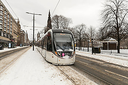 The Beast from the East, Storm Emma hit Edinburgh overnight and has left transport links decimated and many of the shops on the famous Princes Street closed for the day.<br /> <br /> Pictured: The first tram of the day was able to run along Princes Street at 11:15
