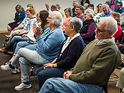 04 MAY 2019 - GRINNELL, IOWA: People in the community room at Drake Community Library in Grinnell, IA, listen to Sen Amy Klobuchar Saturday. Sen. Klobuchar is touring Iowa Saturday to support her bid for the Democratic nomination of for the US Presidency in the 2020 election. Iowa traditionally hosts the the first election event of the presidential election cycle. The Iowa Caucuses will be on Feb. 3, 2020.       PHOTO BY JACK KURTZ