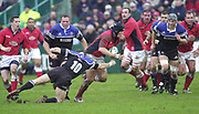 """""""The Rec"""", Bath, West Somerset. Heineken Cup Quarter Final (Sun) 27/01/2002<br /> Bath v LlanelliHeineken Cup Quarter Final Bath Rugby vs Llanelli <br /> Scalets Simon EASTERBY, probes Baths defence. right Steve BORTHWICK, moves in the challenge.<br /> <br /> [Mandatory Credit Peter SPURRIER/Intersport Images]"""