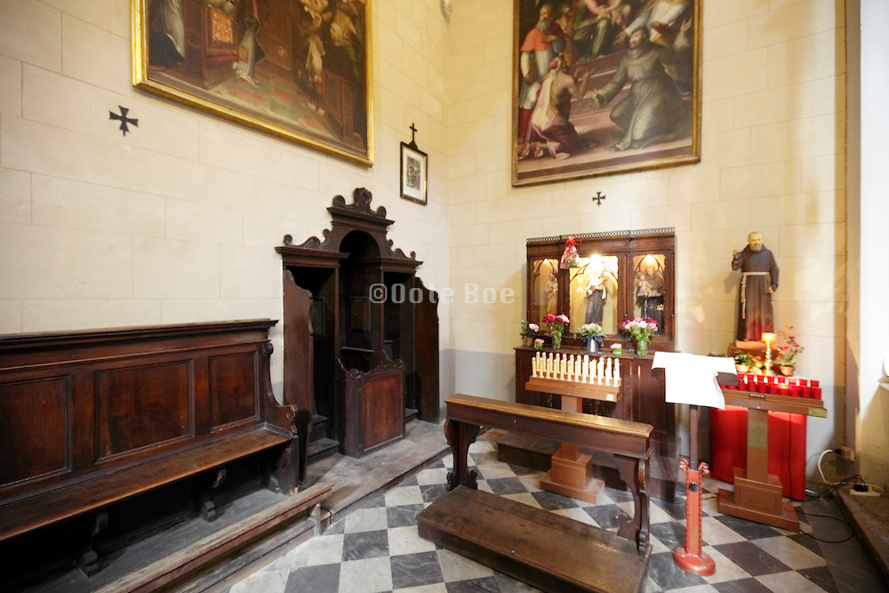 confessional near a little devotional altar Italy