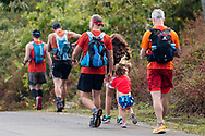 High Point, New Jersey - People walk to the start of the  The Shawangunk Ridge Trail Run/Hike 70-mile race at High Point State Park on Sept. 15, 2017.