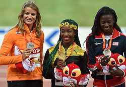 25-08-2015 CHN: IAAF World Championships Athletics day 4, Beijing<br /> Second placed Dafne Schippers (NED), Winner Shelly-Ann Frase-Pryce (JAM) and Tori Bowie (USA) celebrate at 100 m Women medal ceremony. <br /> Photo by Ronald Hoogendoorn / Sportida