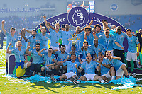 BRIGHTON, ENGLAND - MAY 12:   The Manchester City player celebrate with the Premier League trophy during the Premier League match between Brighton & Hove Albion and Manchester City at American Express Community Stadium on May 12, 2019 in Brighton, United Kingdom. (MB Media)