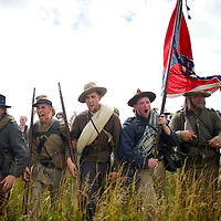 Confederate soldiers scream the rebel yell as an estimated 10,000 people recreated Pickett's Charge at the exact moment it occurred 150 years ago (July 3, 1853) during sesquicentennial Battle of Gettysburg events n Gettysburg, PA on July 3, 2013.