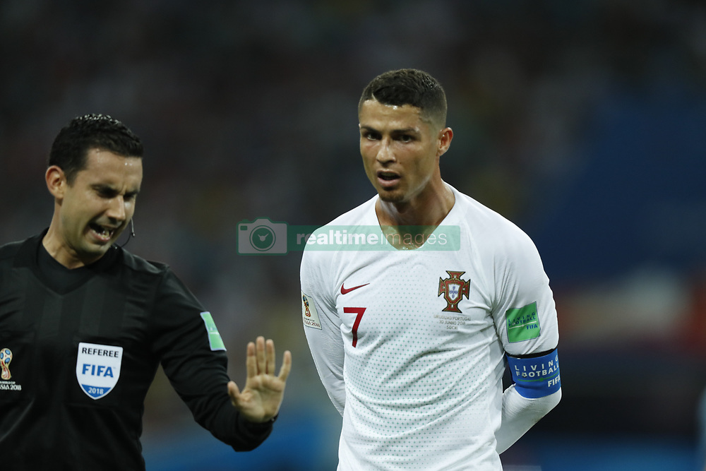 (l-r) referee Cesar Ramos, Cristiano Ronaldo of Portugal during the 2018 FIFA World Cup Russia round of 16 match between Uruguay and at the Fisht Stadium on June 30, 2018 in Sochi, Russia