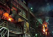 In the heat and dust of a post-communist industrial mill, we see a Bulgarian copper manufacturing process made small against the scale of the Pirdop copper smelting refinery. The refinery is the biggest in the Balkans and whole of South-Eastern Europe. It was privatized in 1997 for $80,000,000 and is now owned by the German Aurubis. It has a capacity of 160,000 tons and additional capacity of 180,000 tons worth €82,000,000 is being built. The factory also produces 830,000 tons of sulphuric acid and employs 1,420 workers. Pirdop is a town located in South-West Bulgaria of Sofia Province in the south-eastern part of the Zlatitsa.