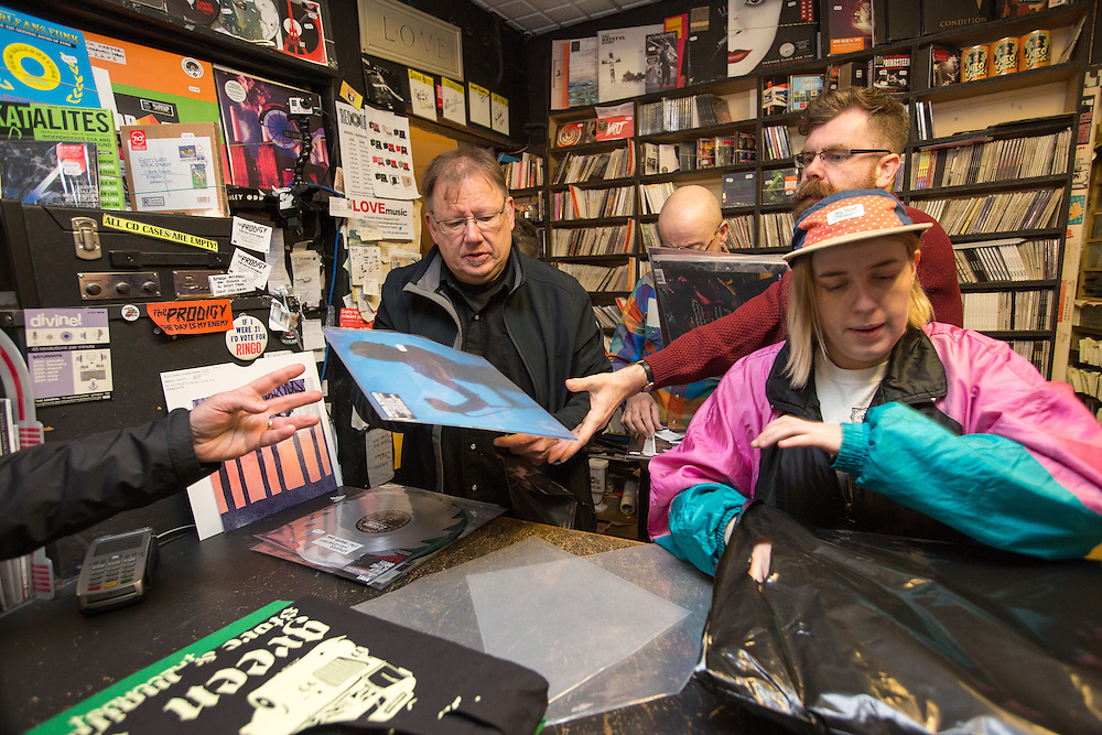 Music fans out in their numbers for Record Store Day. The Love Music shop on Dundas Street, Glasgow. Owner Sandy McLean (L) helping staff during the busy morning rush. Picture Robert Perry 16th April 2016<br /> <br /> Must credit photo to Robert Perry<br /> FEE PAYABLE FOR REPRO USE<br /> FEE PAYABLE FOR ALL INTERNET USE<br /> www.robertperry.co.uk<br /> <br /> NB -This image is not to be distributed without the prior consent of the copyright holder.<br /> in using this image you agree to abide by terms and conditions as stated in this caption.<br /> All monies payable to Robert Perry<br /> <br /> (PLEASE DO NOT REMOVE THIS CAPTION)<br /> This image is intended for Editorial use (e.g. news). Any commercial or promotional use requires additional clearance. <br /> Copyright 2016 All rights protected.<br /> first use only<br /> contact details<br /> Robert Perry     <br /> 07702 631 477<br /> robertperryphotos@gmail.com<br />        <br /> Robert Perry reserves the right to pursue unauthorised use of this image . If you violate my intellectual property you may be liable for  damages, loss of income, and profits you derive from the use of this image.