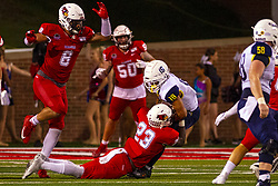 NORMAL, IL - September 21: Brandon Porter stopped by Clayton Isbell during a college football game between the ISU (Illinois State University) Redbirds and the Northern Arizona University (NAU) Lumberjacks on September 21 2019 at Hancock Stadium in Normal, IL. (Photo by Alan Look)