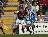 Photo: Ian Hebden.<br />Northampton Town v Chester City. Coca Cola League 2. 29/04/2006.<br />Northampton Towns Andy Kirk (L) battles with Chesters Abdou El-Kholti (R).