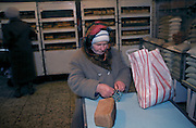 Ulyanovsk, Urals Region, central  Russia, 1994..Shopping at foodstore where produce is only for sale to local residents with food coupons. The birthplace of Vladiimr Lenin, founder of the Soviet Union, remains true to his Communist ideals. There is little private ownership, and all city industry and local agriculture is controlled by the state.