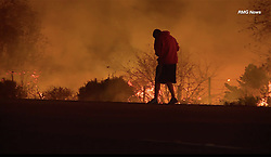 EXCLUSIVE: This is the incredible moment a man rescues rabbit from the raging fires which have hit Ventura and are now heading towards Santa Barbara. The Thomas fire has burnt over 230,000 acres (360 Square miles) which currently makes it California 5th largest fire. 06 Dec 2017 Pictured: Rabbit rescue from flames. Photo credit: RMG News / MEGA TheMegaAgency.com +1 888 505 6342