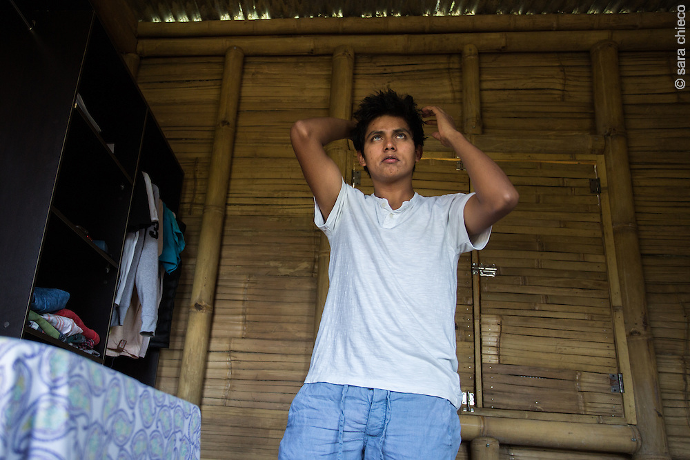 Antonio Cruz Sanchez, 26, gets ready for the day, working for SERES at the SERES Embassy where he also lives. San Juan Del Obispo, Guatemala, July 24, 2014