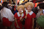 October 29, 2016, Tokyo, Japan: In the Shibuya district, the heart of Japanese youth culture, Halloween celebrations have exploded in the past few years. Up until this boom, Halloween celebrations were minimal across the city. But Shibuya has now become Halloween central with tens of thousands of costumed party goers invading it's streets to promenade en-costume or hit club events in the area. This informal street gathering has become so big, this year the Tokyo Metropolitan Police Dept. decided to close off two main streets adjacent to Shibuya Station. When Oct. 31 falls on a weekday, ninety percent of Halloween celebrations across Japan take place on the preceding Saturday. Pictured here are Little Orphan Annie costumes. (Torin Boyd/Polaris).