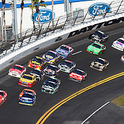 Sprint Cup drivers led by Jamie McMurray (1) race down the front stretch during the Daytona 500 at Daytona International Speedway on February 20, 2011 in Daytona Beach, Florida. (AP Photo/Alex Menendez)