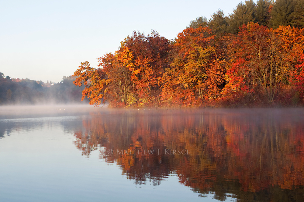 It was a balmy 35 degrees (Fahrenheit) as I approached this scene. Gloves being off for any period of time would prevent me from operating my camera. The lake temperature was warmer than the air temperature and is the reason there is a slight fog on the water. The colors and clear sky were definitely worth it.