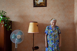 Olga Shevchuk, 70, is seen in her home after attending a Òspecial consultationÓ held by attorneys and paralegals for potential clients who are children of the Second World War, Rivne, Ukraine, June 16, 2011. This vulnerable group is made up of seniors, most of whom are not receiving proper compensation as promised by the government. The legal team advises them on how to properly fill out forms and submit them to the courthouse, while encouraging them not to give up on their rights. More than half of the worldÕs population, four billion people, live outside the rule of law, with no effective title to property, access to courts or redress for official abuse. The Open Society Justice Initiative is involved in building capacity and developing pilot programs through the use of community-based advocates and paralegals in Sierra Leone, Ukraine and Indonesia. The pilot programs, which combine education with grassroots tools to provide concrete solutions to instances of injustice, help give poor people some measure of control over their lives.