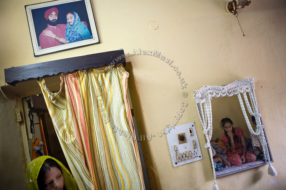 Inside the home of Harjinder Kaur, 57, in Tilak Vihar, New Delhi, India. She has lost her husband and other members of her family during the anti-Sikh riots erupted in New Delhi in 1984 in the light of Indira Gandhi's assassination by her Sikh bodyguards..