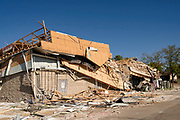 18 AUGUST 2020 - CEDAR RAPIDS, IOWA: A destroyed office building on the west side of Cedar Rapids. Cedar Rapids was the state's hardest hit city by the derecho that roared across Iowa last week. City officials said the damage left by the derecho was more extensive than the 2008 flood that destroyed much of its downtown. City residents are reporting that almost every home was damaged in the storm, many businesses were closed, and up to half of the city's tree canopy was destroyed. A week after the storm, more than 40,000 homes were still without power. A spokesman for Alliant Energy said the utility has replaced as many power poles in one week that they normally replace in 8 months. On Monday, President Trump approved a $4 billion emergency declaration for Iowa to aid in derecho recovery.  PHOTO BY JACK KURTZ