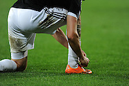 Southampton's Jay Rodriguez ties his boot laces.  Barclays Premier league, Cardiff city v Southampton at the Cardiff city Stadium in Cardiff,  South Wales on Boxing day, Thursday 26th Dec 2013. <br /> pic by Andrew Orchard, Andrew Orchard sports photography.