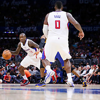 07 October 2014: Los Angeles Clippers guard Jamal Crawford (11) drives past Golden State Warriors guard Andre Iguodala (9) on a screen set by Los Angeles Clippers forward Glen Davis (0) during the Golden State Warriors 112-94 victory over the Los Angeles Clipper, in preseason opener, at the Staples Center, Los Angeles, California, USA.