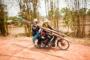 08 APRIL 2010 - NAKHON PHANOM, THAILAND: Women leave a fishing pond in Non Siivilai, Nakhon Phanom province, Thailand. The pond is controlled by a nearby Buddhist temple which allows people to pay a small fee and fish in the pond one day per year. It's a fund raiser for the temple. This year the pond was less than half its normal size and the fishing catch was much smaller than normal. According to people who live here, the Mekong River is at its lowest point in nearly 50 years. Many of the people who live along the river farm and fish. They claim their crops yields are greatly reduced and that many days they return from fishing with empty nets. The river is so shallow now that fisherman who used to go out in boats now work from the banks and sandbars on foot or wade into the river. In addition to low river levels the Isan region of Thailand is also in the midst of a record drought and heat wave. Farmers have been encouraged to switch from rice to less water intensive crops and to expect lower yields. Farmers here rely more on rain fall than irrigation to water their crops.       PHOTO BY JACK KURTZ