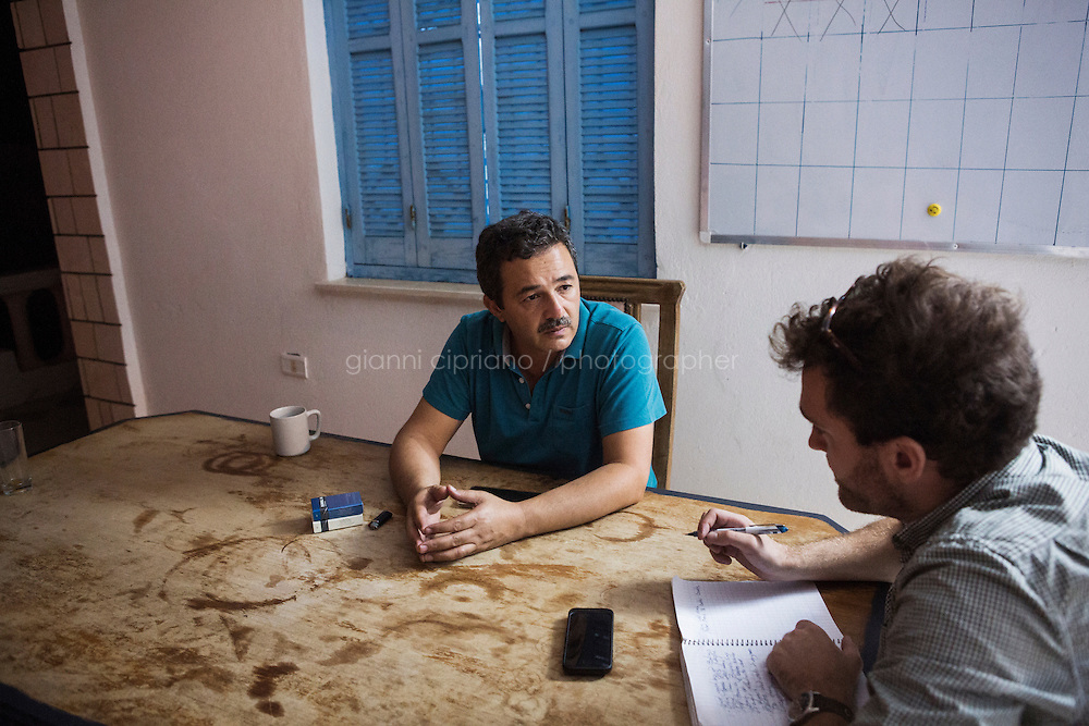 ZARZIS, 12 OCTOBER 2015: Fouad Gamoudi, Project Coordinator for Médecins Sans Frontières, is interviewed here journalist Eric Reidy of the MSF headquarters in Zarzis, Tunisia, on October 12th 2015. Fouad Gamoudi has set up a search and rescue training program for the fishermen of Zarzis.