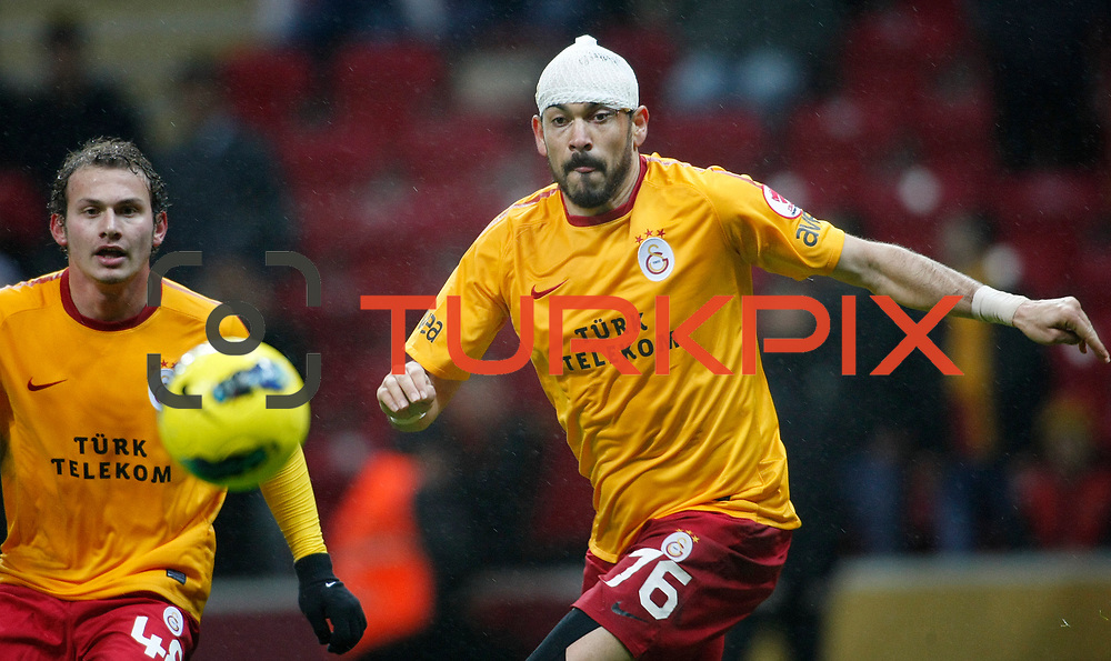 Galatasaray's Servet Cetin (R) during their Turkey Cup matchday 3 soccer match Galatasaray between AdanaDemirspor at the Turk Telekom Arena at Aslantepe in Istanbul Turkey on Tuesday 10 January 2012. Photo by TURKPIX