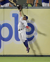 September 12, 2017 - Arlington, TX, USA - Texas Rangers right fielder Shin-Soo Choo just misses a double by the Seattle Mariners' Robinson Cano during the sixth inning at Globe Life Park in Arlington, Texas, on Tuesday, Sept. 12, 2017. (Credit Image: © Max Faulkner/TNS via ZUMA Wire)