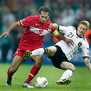 Turkey's Hamit ALTINTOP (L) and Germany's Marco REUS (R) during their UEFA EURO 2012 Qualifying round Group A matchday 19 soccer match Turkey betwen Germany at TT Arena in Istanbul October 7, 2011. Photo by TURKPIX