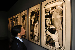 """London, UK.  17 May 2017.  A visitor views """"Shunjuku Station, Tokyo, Japan"""", 1962 by Hiro.  Preview of Photo London 2017 at Somerset House.  Held for the third time, the event showcases the best in contemporary photography, from 89 galleries from 16 different countries, for collectors and enthusiasts and will be on from 18 - 21 May. Credit: Stephen Chung / Alamy Live News"""