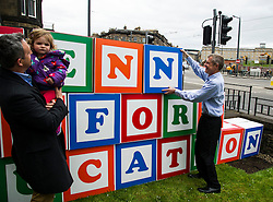 """Pictured: Alex Col-Hamilton and his daughter  Darcy helped Willie Rennie build his pledge<br /> <br /> Scottish Liberal Democrat leader Willie Rennie made his final pitch for votes today as he unveiled large building blocks that spelt out the party's flagship """"Penny for education"""" policy. Scottish Liberal Democrats HQ, 4, EH12 5DR. Adam Clarke 07450 980 386.the election on Thursday.<br /> <br /> Ger Harley 