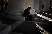 Un fedele tra le colonne di San Pietro, Roma 07 dicembre 2015. Christian Mantuano / OneShot<br /> <br /> A faithful under the columns of St. Peter's Basilica, Rome, on December 7, 2015. Christian Mantuano / OneShot