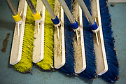 Industrial brooms in the cleaning cupboard of a prison wing. HMP/YOI Portland, a resettlement prison with a capacity for 530 prisoners.Dorset, United Kingdom.