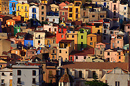 The crazy colours of the houses of Bosa, a charming town on the shores of Temo river and along the western coast of Sardinia, half way between Alghero and Oristano. Bosa is famous for the crazy, vivid colours of the houses surrounding a medieval fortress.