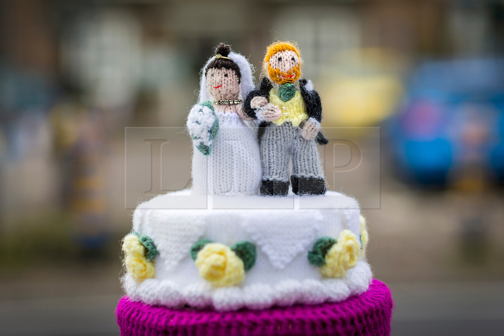 © Licensed to London News Pictures. 13/05/2018. Thirsk UK. Linda Miller's woollen depiction of Prince Harry & Megan Markle's wedding day. The Thirsk Yarn bombers have decorated the town centre of Thirsk in North Yorkshire this morning with Prince Harry & Megan Markle wedding related woollen creations to celebrate the upcoming royal wedding at the weekend. Photo credit: Andrew McCaren/LNP