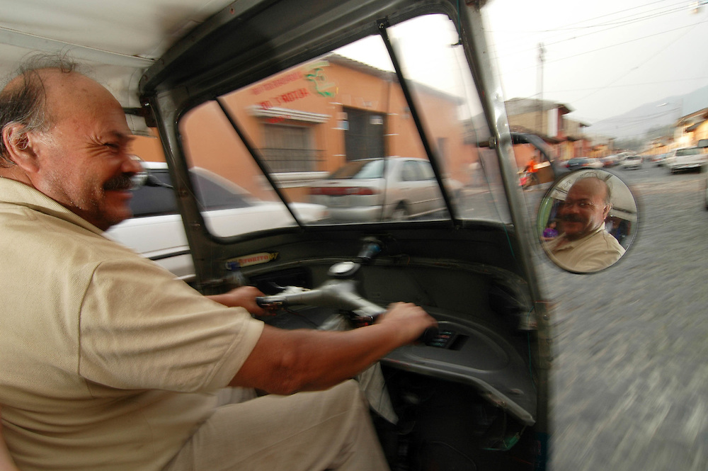 A Tuk Tuk driver navigating the cobblestone streets of Antigua, Guatemala.