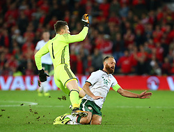 October 9, 2017 - Cardiff City, Walles, United Kingdom - Wayne Hennessey of Wales  gets tackled by David Meyler of Republic of Ireland .during FIFA World Cup group qualifier match between Wales and Republic of Ireland at the Cardiff City Stadium, Cardiff, Wales on 9 October 2017. (Credit Image: © Kieran Galvin/NurPhoto via ZUMA Press)