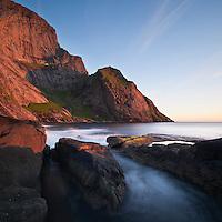 Cliff rise from sea, Bunes Beach, Lofoten islands, Norway