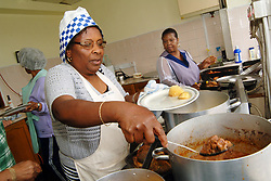 Women cook lunch for the Dominican Association Community Centre, Bradford West Yorkshire UK