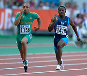 Tim Montgomery of the United States (1418) and Sherwin Vries (1156) of South Africa in the IAAF World Championships in Athletics at Stade de France on Sunday, Aug, 24, 2003.