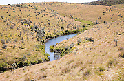 Meandering small Belihul Oya river in V shaped valley Horton Plains national park, Sri Lanka, Asia